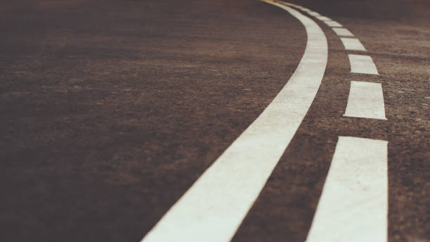 white curved city road marking - dotted line stock photos and pictures
