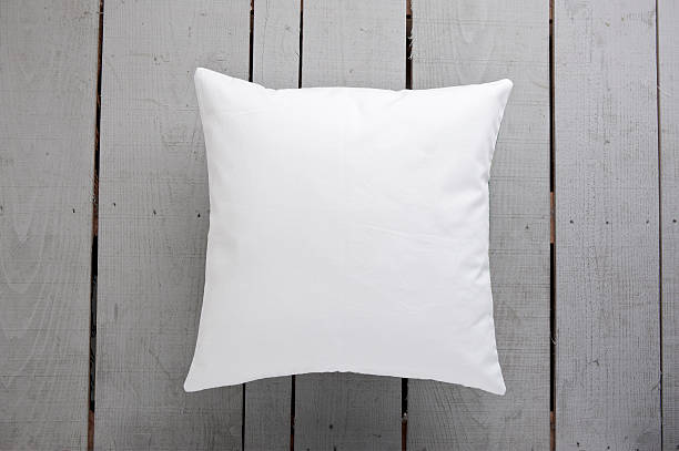 White cushion on wooden background stock photo