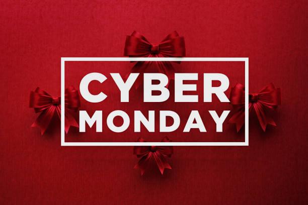 белый cyber понедельник текст на красный лук связей - cyber monday стоковые фото и изображения