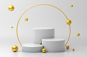 istock White cylinders and golden spheres. 1281648142