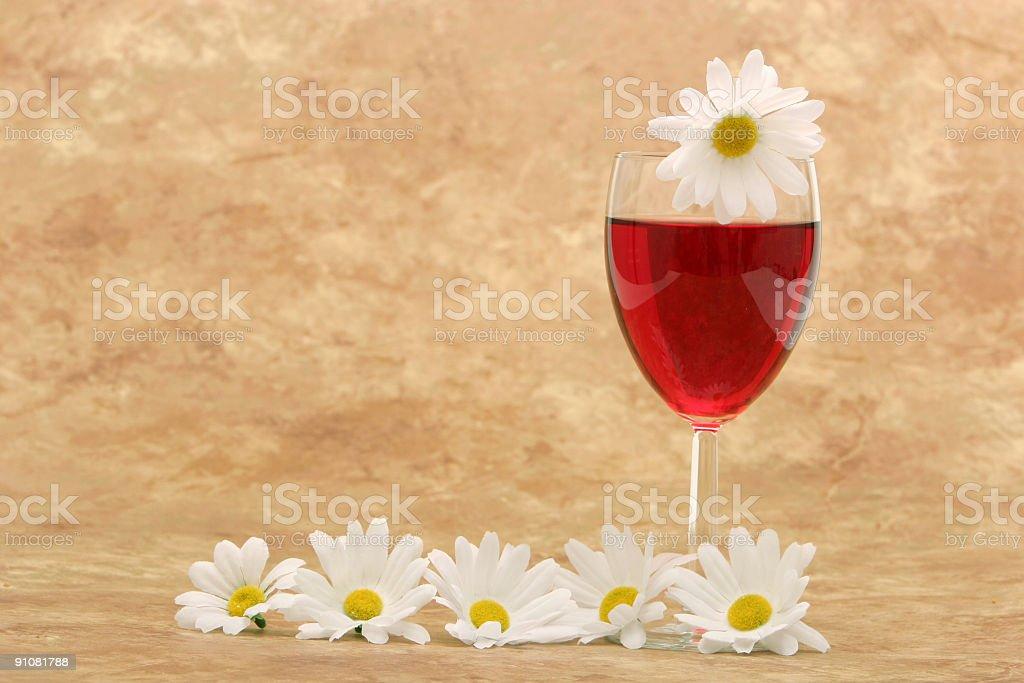 White daisies and red wine stock photo