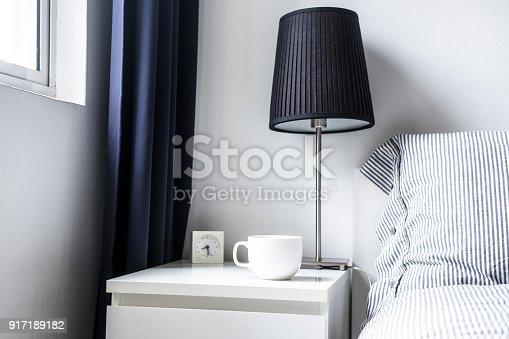 istock White dark blue minimalist bedroom design 917189182