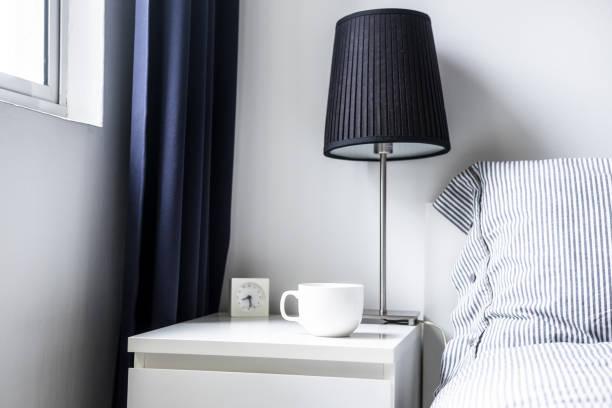 White dark blue minimalist bedroom design stock photo