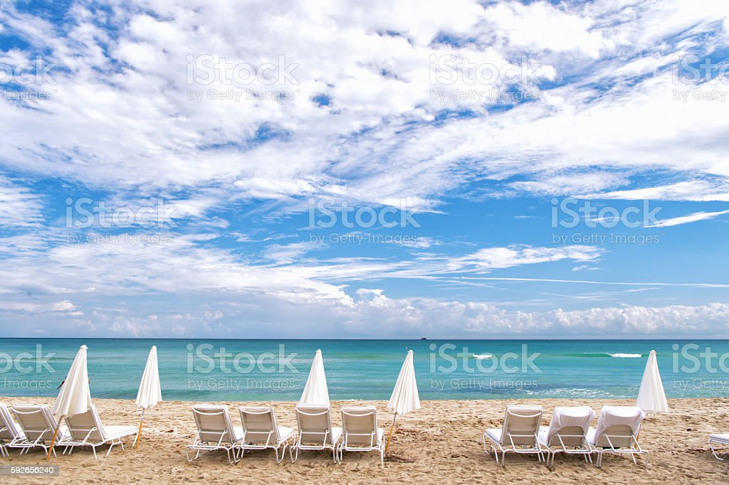 White deck chairs in South beach, Miami stock photo