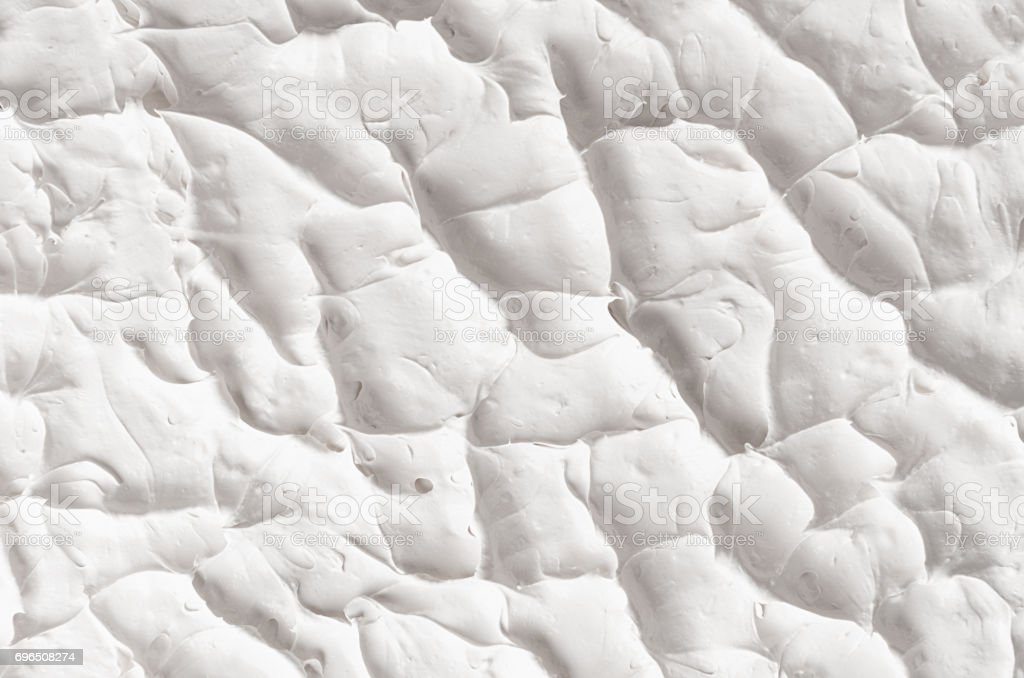 White decorative abstract plaster texture with splash and ribbed. stock photo
