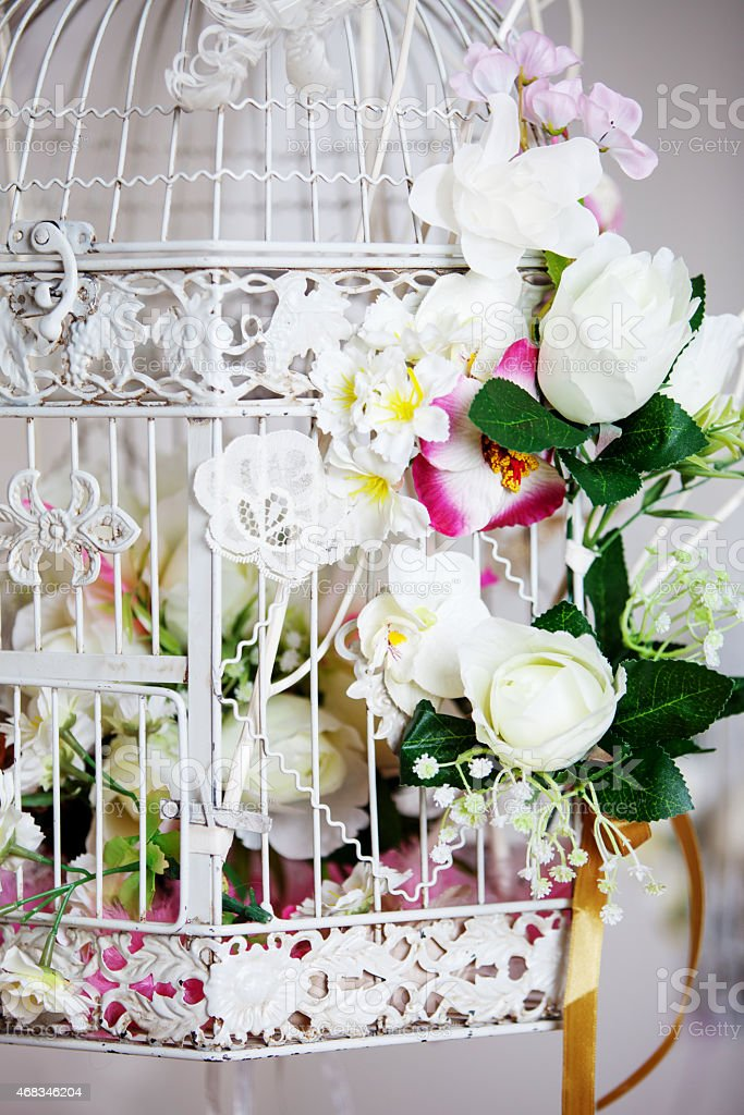 White decorative cage with beautiful flowers, close up royalty-free stock photo