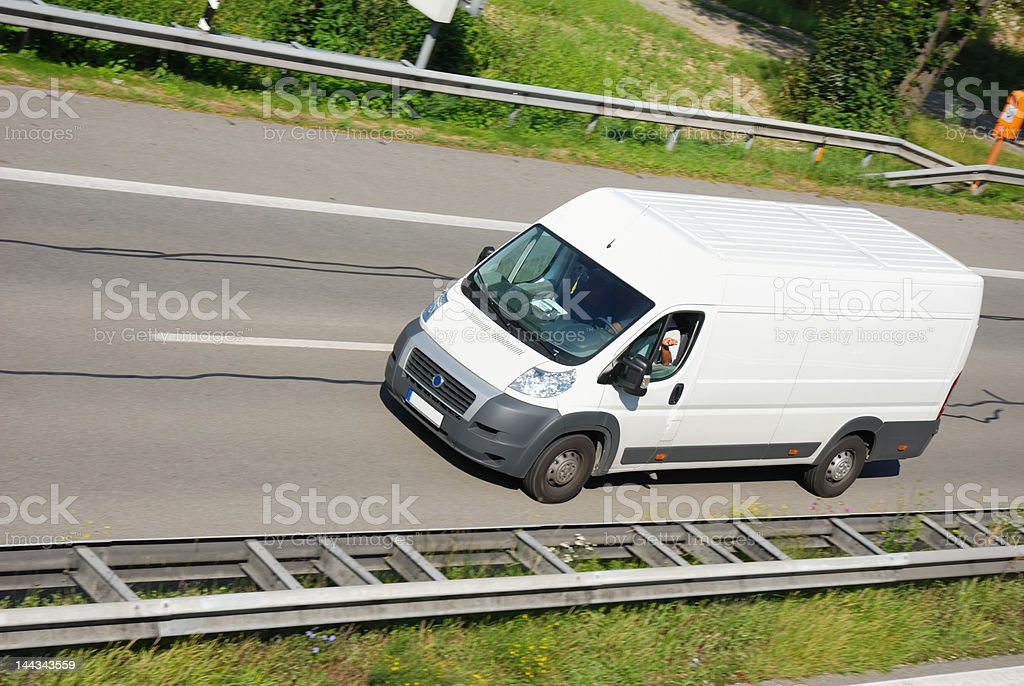 white delivery truck on highway stock photo