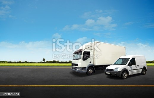 istock White Delivery Van and Truck on the Road 972823374