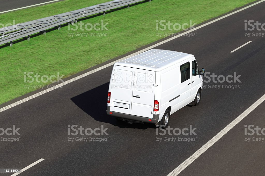 White delivery van driving on a highway stock photo