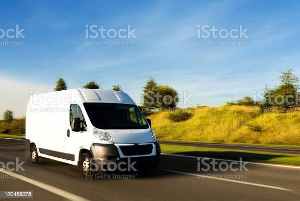 A van speeding on the highway