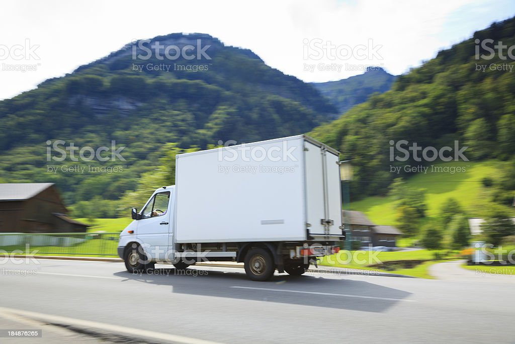 white delivery van with alps in background royalty-free stock photo