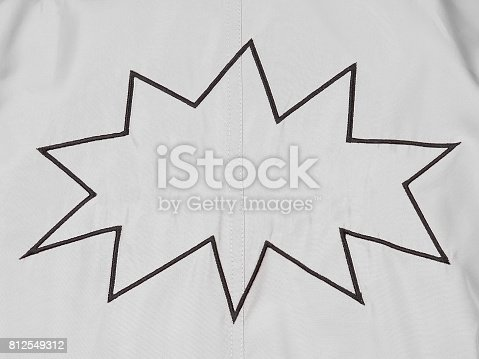 istock White denim background with cartoon balloon boom embroidery with empty space 812549312