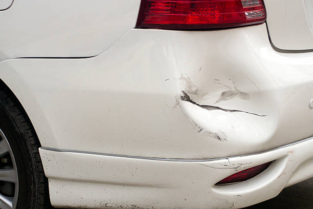 White dented car, broken car stock photo