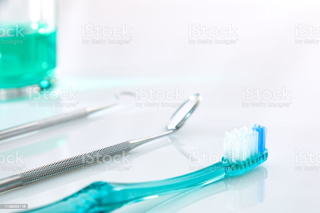 White dentist table with tools and teeth cleaning concept detail stock photo