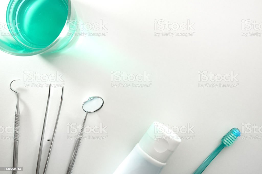 White dentist table with tools and teeth cleaning concept top stock photo