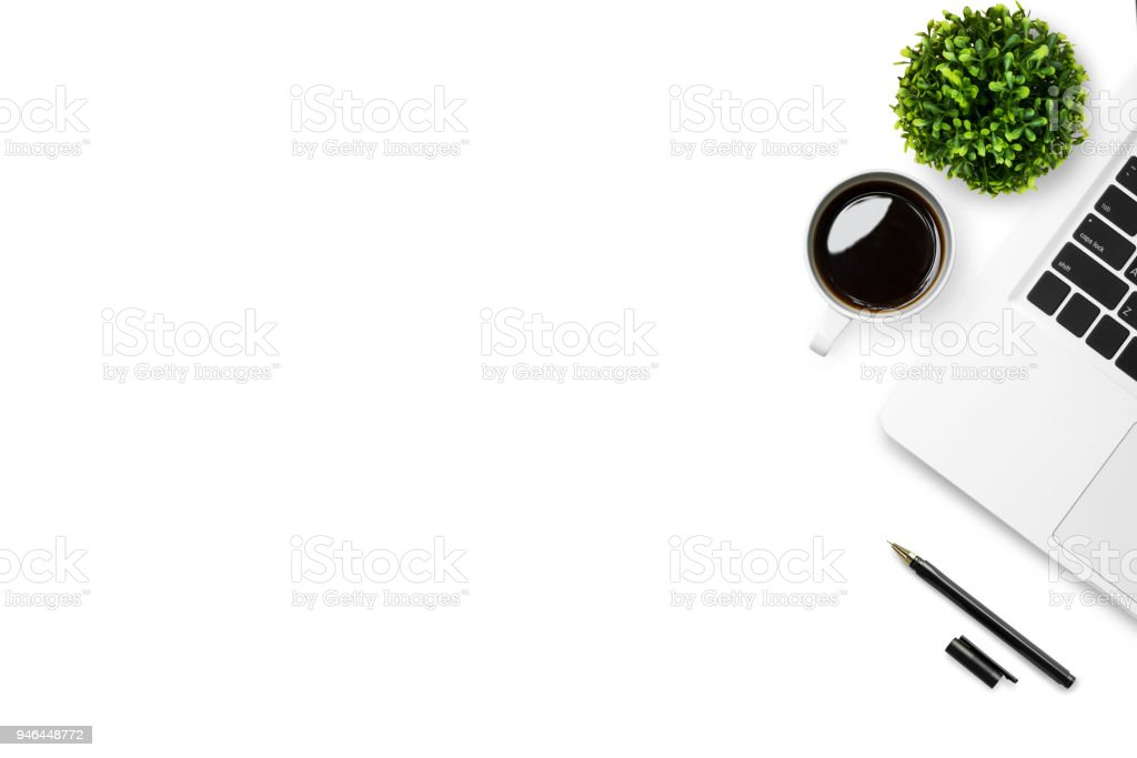 White desk office table with laptop, coffee and pen. Top view with...