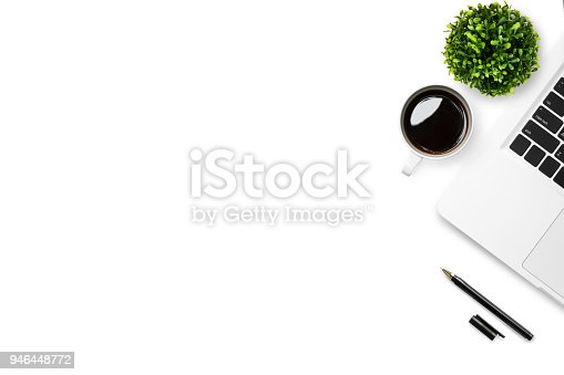 White desk office table with laptop, coffee and pen. Top view with copy space, flat lay.