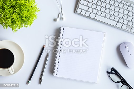 istock White desk office with laptop, smartphone and other supplies with cup of coffee. Top view with copy space for input the text. Designer workspace on desk top, view with essential elements on flat lay. 1008147218