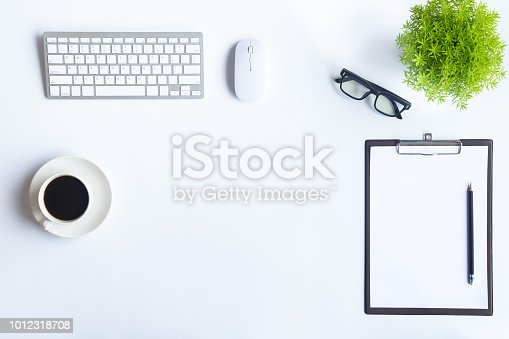 istock White desk office with laptop, smartphone and other supplies with cup of coffee. Top view with copy space for input the text. Designer workspace on desk top, view with essential elements on flat lay. 1012318708