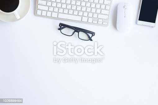 istock White desk office with laptop, smartphone and other supplies with cup of coffee. Top view with copy space for input the text. Designer workspace on desk top, view with essential elements on flat lay. 1026899464