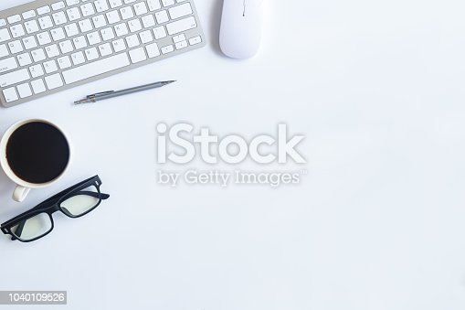 istock White desk office with laptop, smartphone and other supplies with cup of coffee. Top view with copy space for input the text. Designer workspace on desk top, view with essential elements on flat lay. 1040109526
