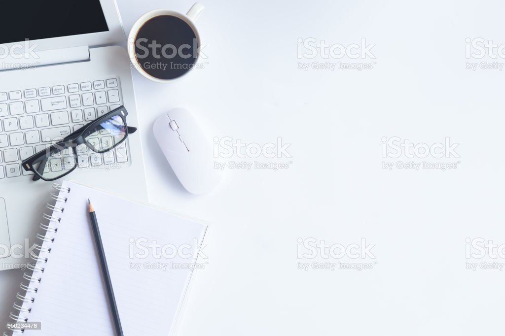 White desk office with laptop, smartphone and other supplies with cup of coffee. Top view with copy space for input the text. Designer workspace on desk top, view with essential elements on flat lay. - Zbiór zdjęć royalty-free (Aranżować)