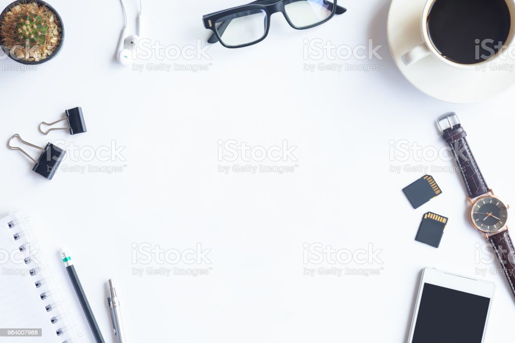 White desk office with laptop, smartphone and other supplies with cup of coffee. Top view with copy space for input the text. Designer workspace on desk top, view with essential elements on flat lay. - Royalty-free Above Stock Photo