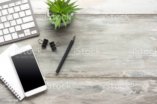 Photo of White desk office with laptop, smartphone and other work supplies with cup of coffee. Top view with copy space for input the text. Designer workspace on desk table essential elements on flat lay.