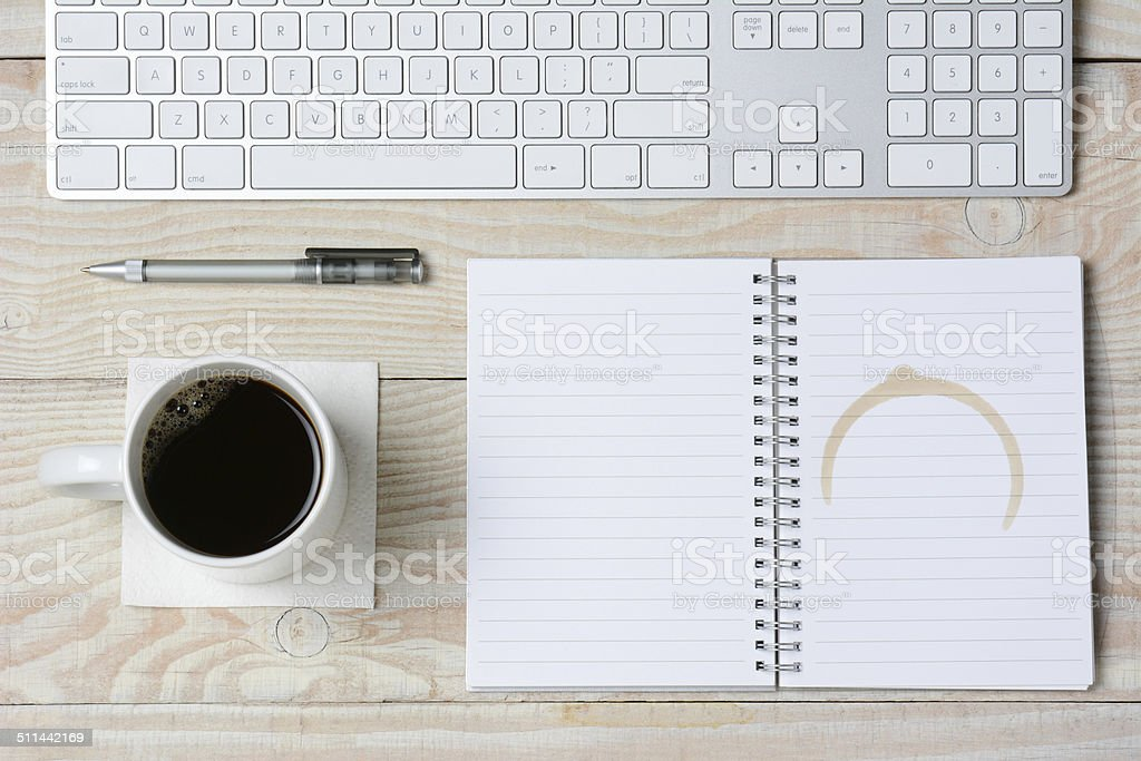 White Desk With Coffee and Keyboard stock photo