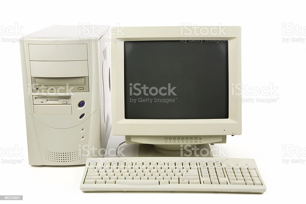A white desktop computer with keyboard, tower and monitor stock photo