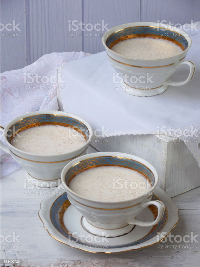 White dessert Junket from milk and rennet extract with cinnamon in cups on light background. Jelly-like pudding made from sweet cottage cheese. Healthy food. Space for text stock photo