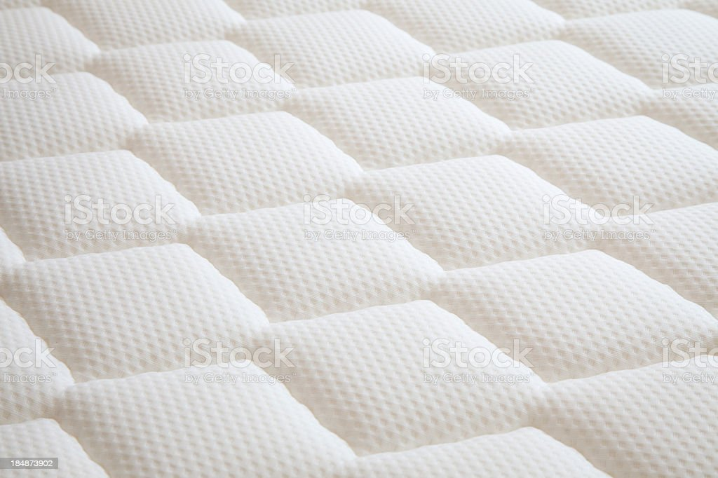 White diamond shaped mattress background stock photo