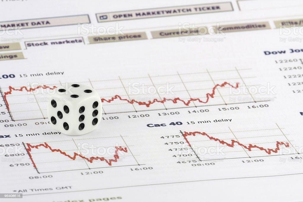 White dice over stock market graphs stock photo