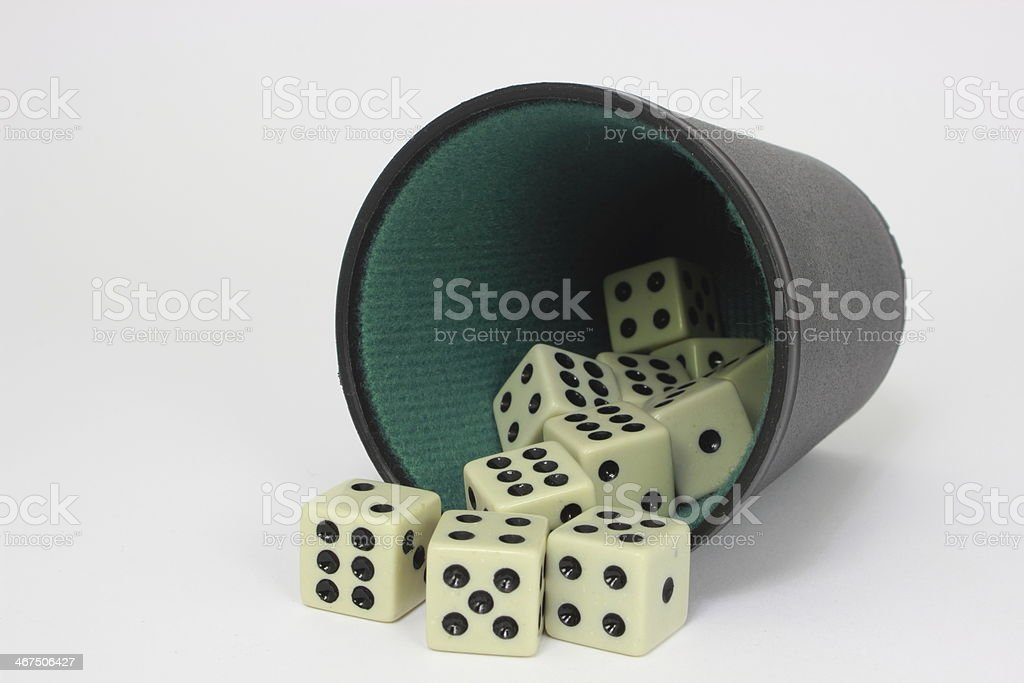 White dice with black and green cup - isolated stock photo