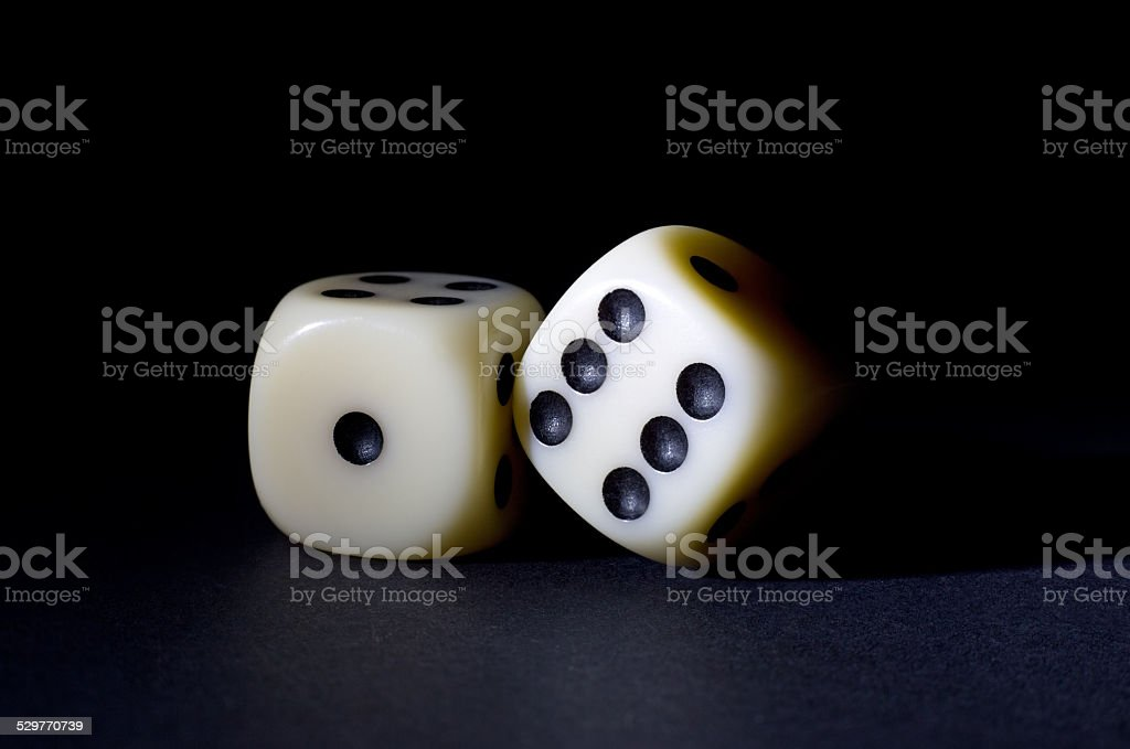 White Dices Isolated on Black Background stock photo
