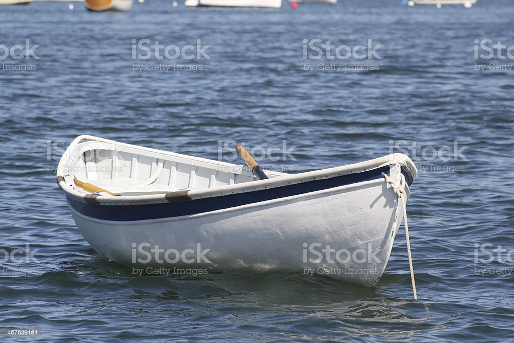 White Dinghy Moored in Blue Harbor royalty-free stock photo