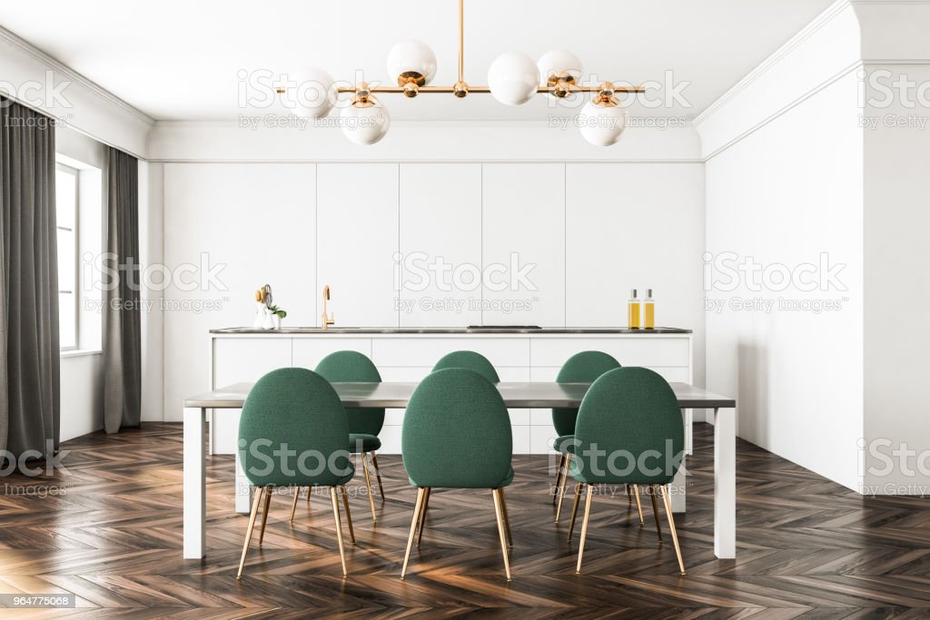 White dining room and kitchen, green chairs royalty-free stock photo