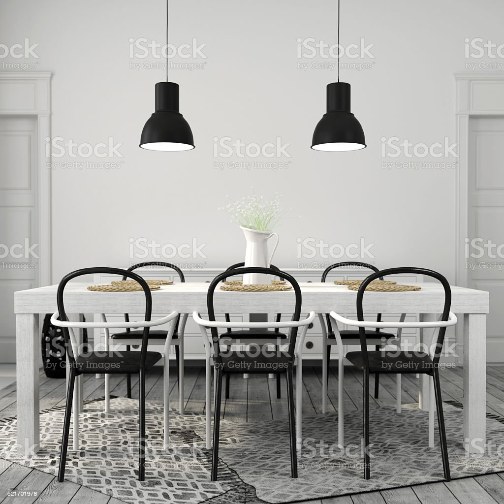 white dining table with black chairs stock photo