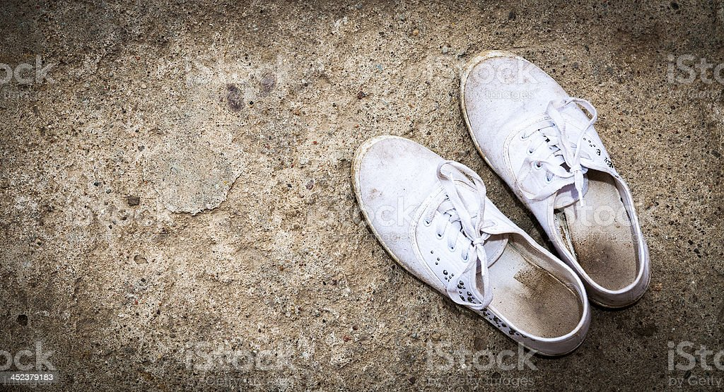 White dirty shoes royalty-free stock photo