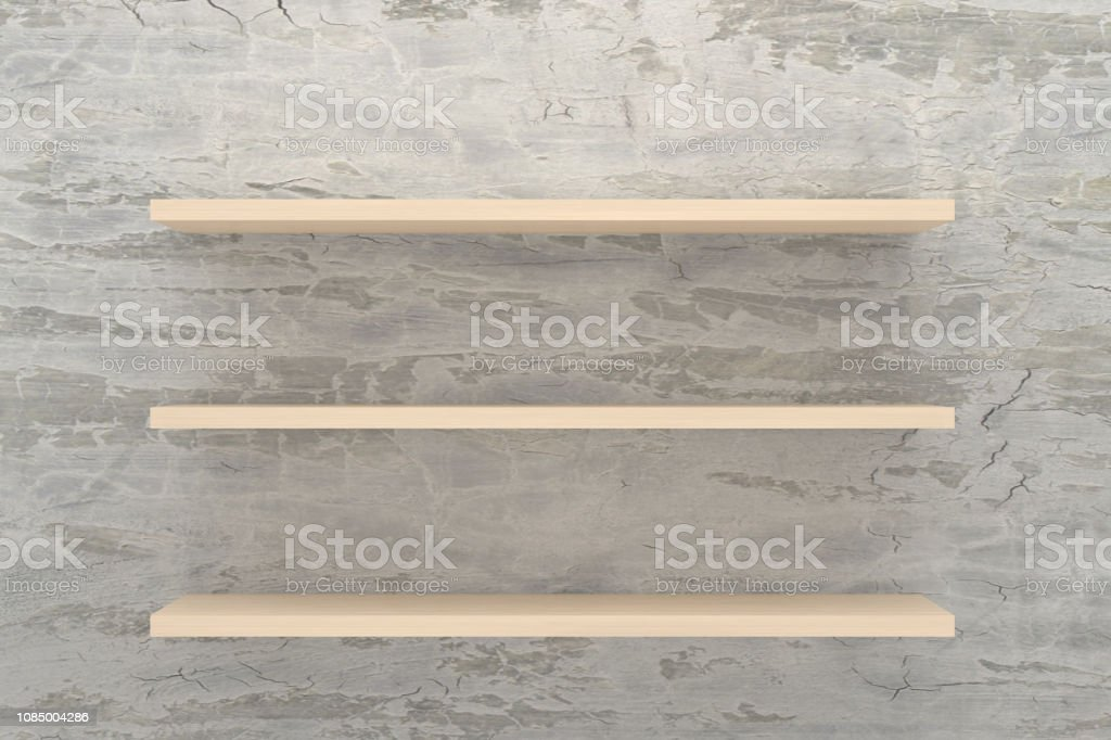 White dirty stone wall and empty wooden shelf