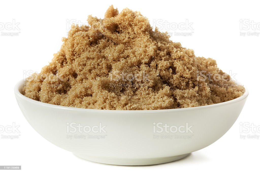 White dish of brown sugar on white background stock photo