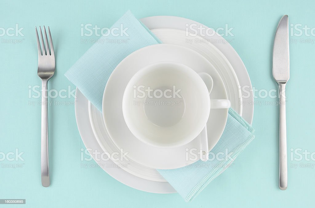 White dishes on aqua tablecloth royalty-free stock photo