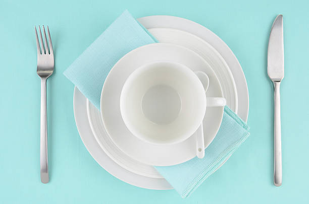 white dishes on aqua tablecloth - blue table setting stock photos and pictures