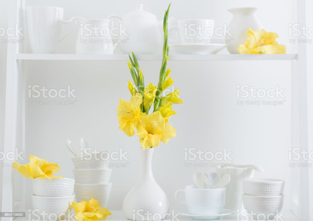 white dishvare with flowers on wooden shelf royalty-free stock photo