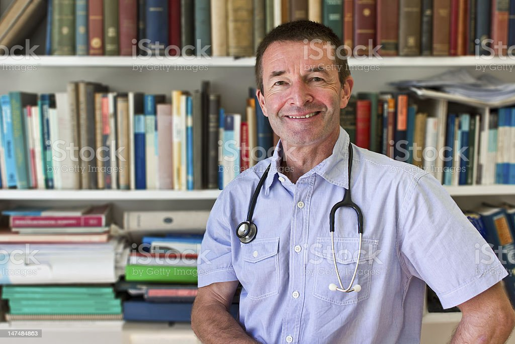 White Doctor In Front Of Books royalty-free stock photo
