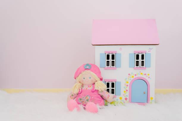 White doll house with pink roof with blue shutters and a nice doll picture id1224948973?b=1&k=6&m=1224948973&s=612x612&w=0&h=vbpijbg6looumijbyz7rvdpymczp8 7rh3zebfjbj6c=