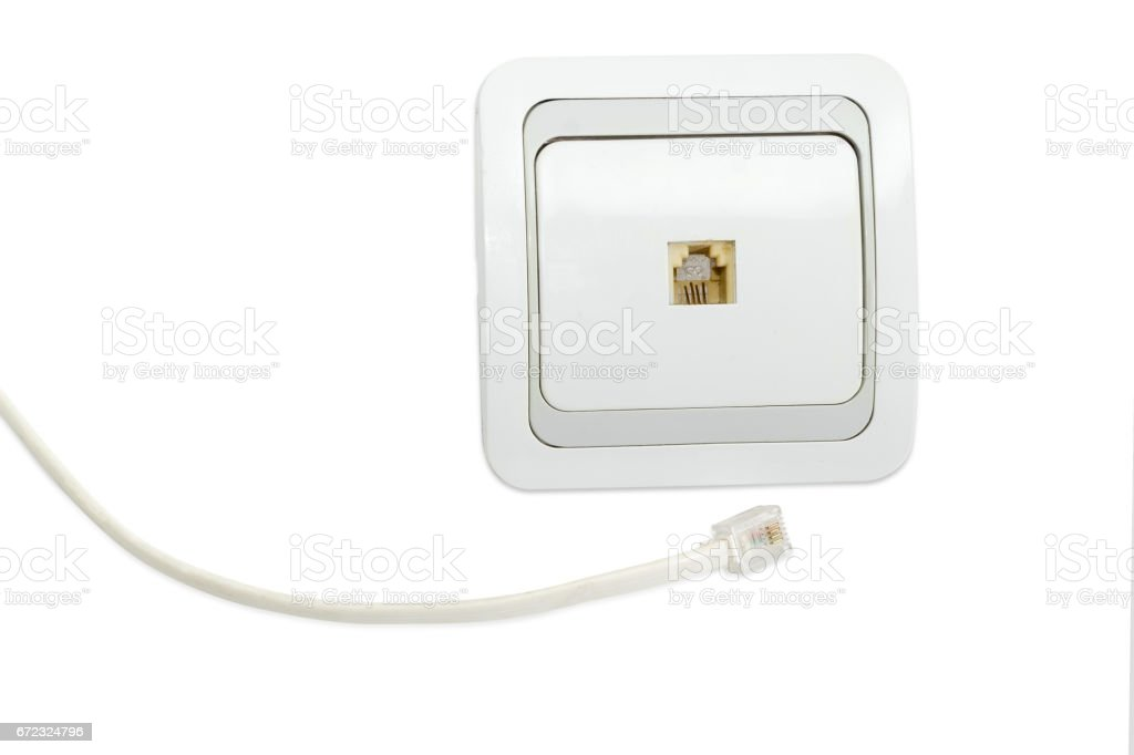 White domestic telephone socket and part of corresponding telephone cable stock photo