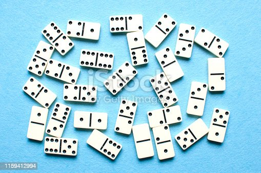 White domino pieces on a blue background.