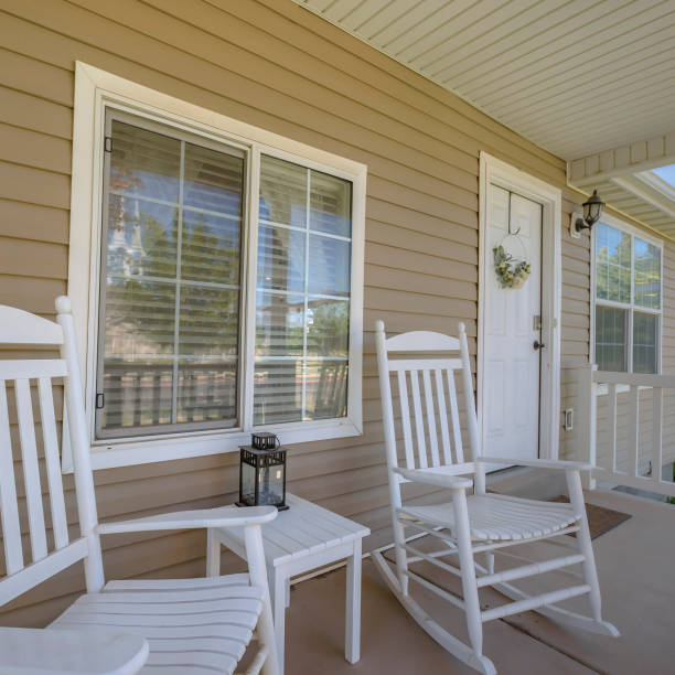 White door and porch with rocking chairs and table stock photo