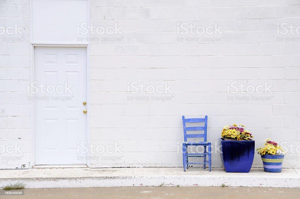 White Door Blue Chair stock photo